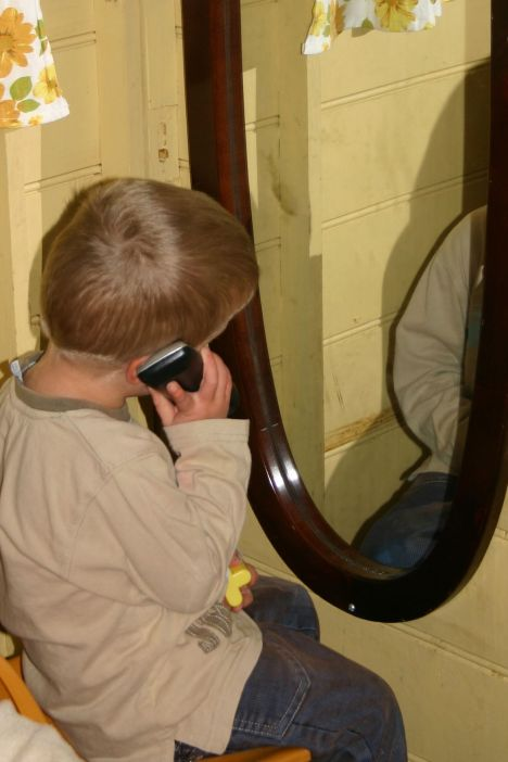 watching self on phone in mirror IMG_0327